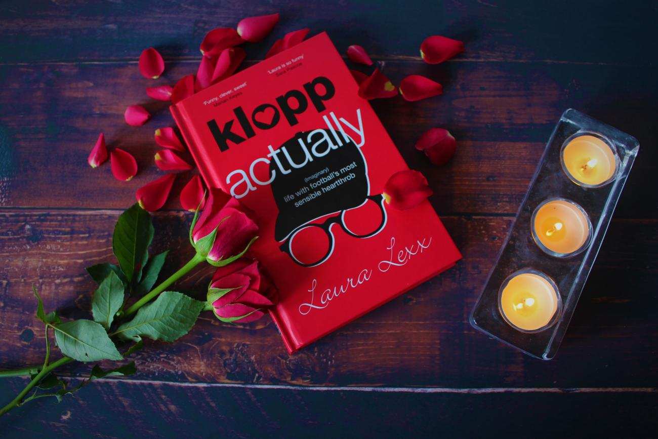 Klopp Actually hardback lying with rose petals, candles and roses